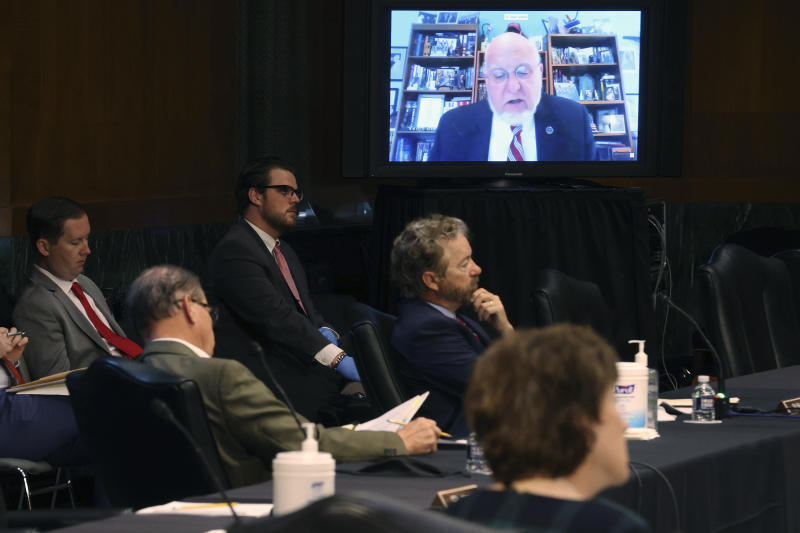 Senators and staff listen to Dr. Robert Redfield, director of the Centers for Disease Control and Prevention, speak remotely during a virtual Senate Committee for Health, Education, Labor, and Pensions hearing, Tuesday, May 12, 2020 on Capitol Hill in Washington. (Win McNamee/Pool via AP)