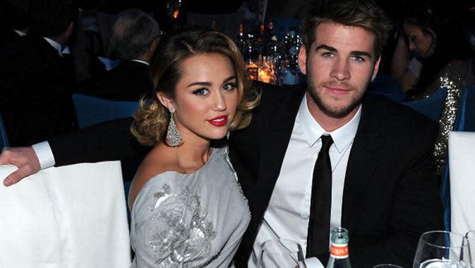 Miley Cyrus dan Liam Hemsworth. (AFP/Larry Bussaca)
