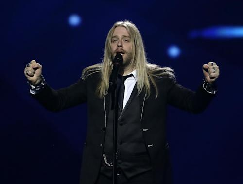 "Eythor Ingi of Iceland performs his song ""Eg A Lif"" (I am Alive) during a rehearsal for the final of the Eurovision Song Contest at the Malmo Arena in Malmo, Sweden, Friday, May 17, 2013. The contest is run by European television broadcasters with the event being held in Sweden as they won the competition in 2012, the final will be held in Malmo on May 18. (AP Photo/Alastair Grant)"