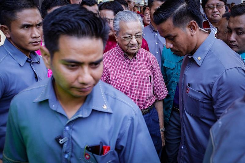 Prime Minister Tun Dr Mahathir Mohamad (centre) leaves after attending the Chinese New Year Open House hosted by Gerakan at the PGRM Tower in Kuala Lumpur January 25, 2020. — Picture by Hari Anggara