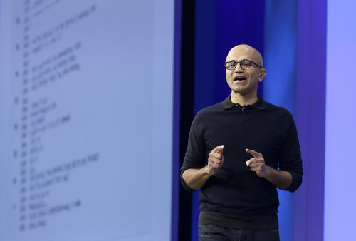 "Microsoft CEO Satya Nadella speaks at Microsoft's annual ""Build"" conference in San Francisco, Wednesday, April 29, 2015. While Microsoft has already previewed some aspects of the new Windows 10, a parade of top executives will use the conference to demonstrate more software features and app-building tools, with an emphasis on mobile devices as well as PCs. (AP Photo/Jeff Chiu)"