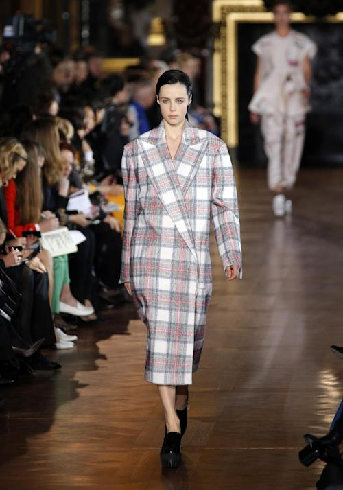 A model wears a creation by fashion designer Stella McCartney for her Fall/Winter 2013-2014 ready to wear collection, in Paris, Monday, March, 4, 2013. (AP Photo/Christophe Ena)