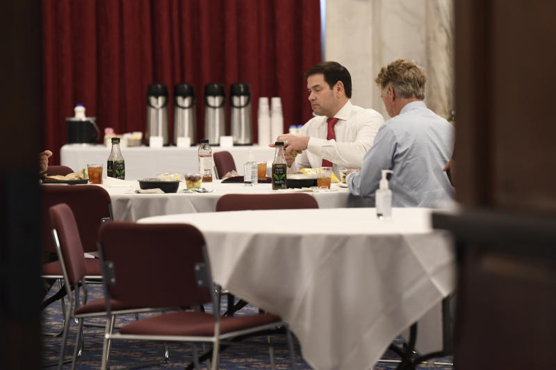 Sen. Rand Paul, R-Ky., right, Sen. Marco Rubio, R-Fla., left, have lunch at a Republican policy lunch on Capitol Hill in Washington, Friday, March 20, 2020. Paul tested positive for the coronavirus. (AP Photo/Susan Walsh)