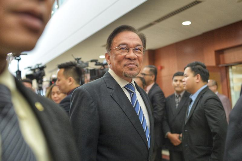 Datuk Seri Anwar Ibrahim leaves after answering media questions at the Parliament building in Kuala Lumpur November 20, 2019. — Picture by Shafwan Zaidon