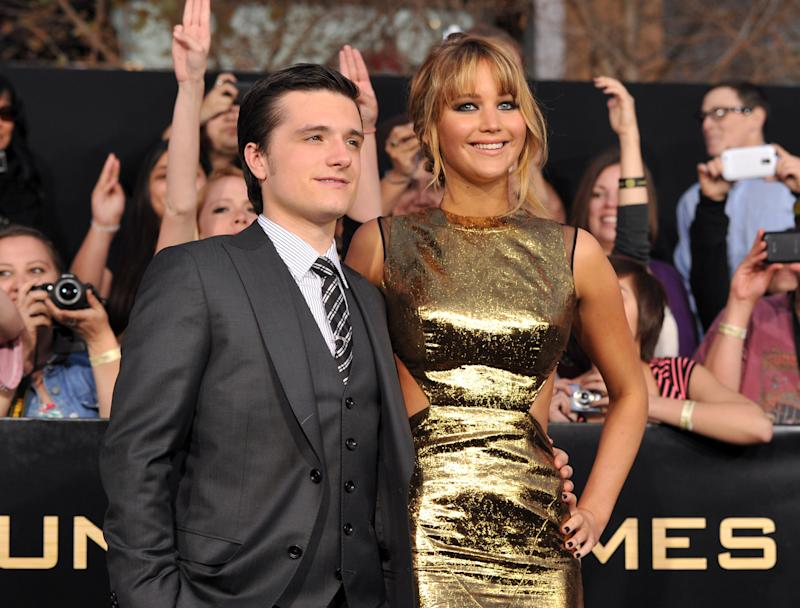 """LOS ANGELES, CA - MARCH 12: Actors Josh Hutcherson (L) and Jennifer Lawrence arrive at the premiere of Lionsgate's """"The Hunger Games"""" at Nokia Theatre L.A. Live on March 12, 2012 in Los Angeles, California. (Photo by Kevin Winter/Getty Images)"""