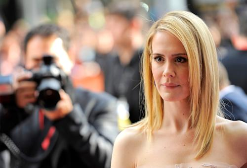 """Sarah Paulson arrives at the premiere for """"12 Years a Slave"""" on day 2 of the Toronto International Film Festival at The Princess of Wales Theatre on Friday, Sept. 6, 2013, in Toronto. (Photo by Chris Pizzelloi/Invision/AP)"""
