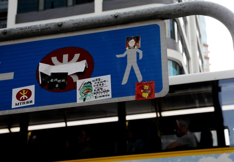 A sticker bearing an image of Hong Kong's Chief Executive Carrie Lam is attached on a road sign in Hong Kong