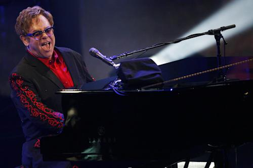 Elton John performs at the Roundhouse in London as part of the iTunes Festival, Thursday, Sept. 12, 2013. (Photo by Jim Ross/Invision/AP)
