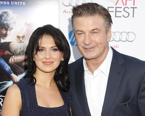 "FILE - This Nov. 4, 2012 file photo shows actor Alec Baldwin, right, and his wife Hilaria Thomas at the ""Rise Of The Guardians'"" special screening during the 2012 AFI FEST at Grauman's Chinese Theatre in the Hollywood section of Los Angeles. A representative for Alec Baldwin says the ""30 Rock"" star and his wife Hilaria are expecting their first child together. Baldwin, 54, is already the father of a 17-year-old daughter, Ireland, from his previous marriage to actress Kim Basinger (Photo by Todd Williamson/Invision/AP, file)"