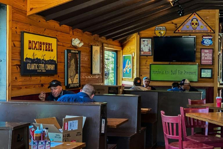 Brian Mancuso, the owner of Moe's Original BBQ restaurant in Atlanta, said he was happy to see customers dining in his establishment -- albeit at a greater distance from each other than before