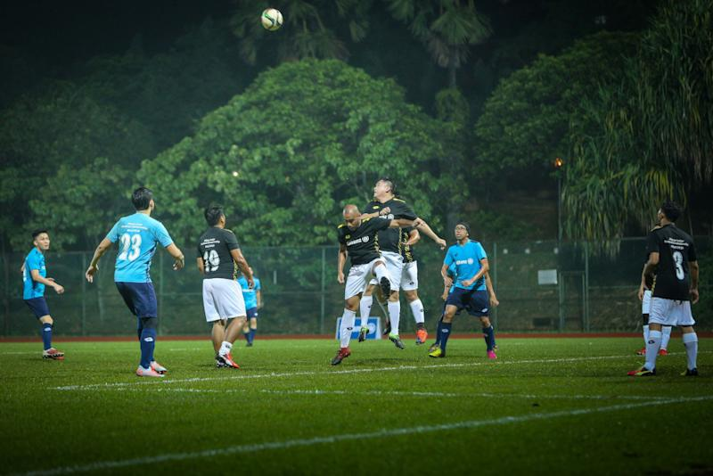 Players vie for the ball during the friendly match at Stadium UM Arena. — Picture courtesy of Allianz Malaysia Berhad