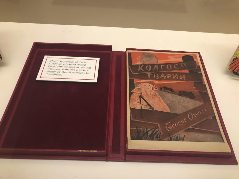 """In this Oct. 21, 2019, photo, Ukrainian version George Orwell's novel """"Animal Farm"""" is shown at an exhibit in Albuquerque, N.M. celebrating the author's legacy. The exhibit at the University of New Mexico is tackling the themes of the novelist's work from """"1984"""" to """"Animal Farm."""" """"George Orwell: His Enduring Legacy,"""" which runs to April 2020, features posters and material related to work challenging totalitarianism. (AP Photo/Russell Contreras)"""