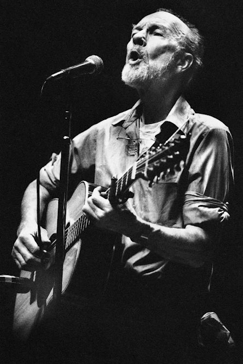 File- This Feb. 25, 1984, file photo shows folk singer Pete Seeger performing in a one-man benefit concert in Berkeley, Calif., at the Berkeley Community Theater. The American troubadour, folk singer and activist Seeger died Monday Jan. 27, 2014, at age 94. (AP Photo/Mark Costantini, File)