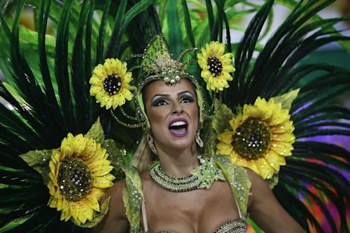 A performer from the Unidos de Vila Isabel samba school parades during Carnival celebrations at the Sambadrome in Rio de Janeiro, Tuesday, Feb. 12, 2013. Rio de Janeiro's samba schools vied for the title of the year's best in an over-the-top, all-night-long Carnival parade at the city's iconic Sambadrome. (AP Photo/Silvia Izquierdo)