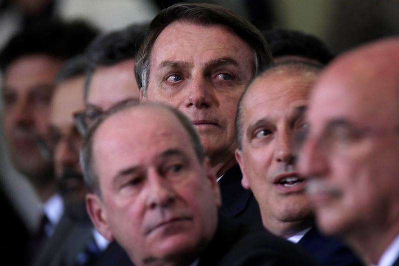 Brazil's President Jair Bolsonaro looks on during the ceremony of the 300 days of Government, in Brasilia