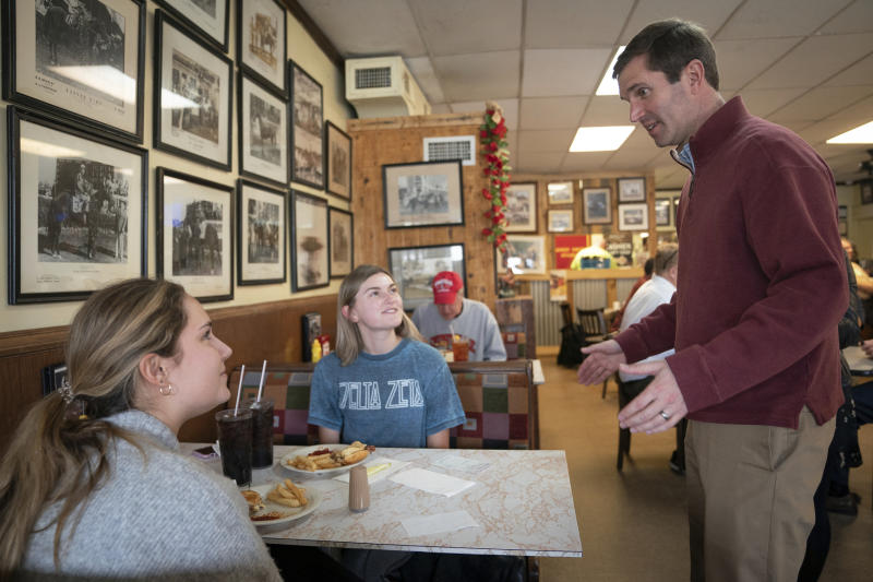 Kentucky Attorney General and Democratic gubernatorial candidate Andy Beshear speaks with voters during a campaign stop at Wagner's Pharmacy, on Election Day, Tuesday, Nov. 5, 2019, in Louisville, Ky. (AP Photo/Bryan Woolston)