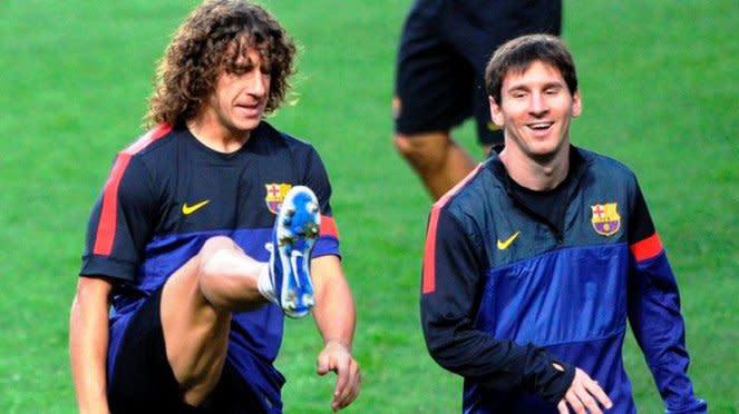 Carles Puyol dan Lionel Messi