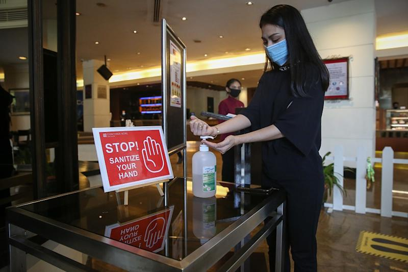 A hotel guest sanitises her hands at the lobby of the Concorde Hotel in Shah Alam June 9, 2020. — Picture by Yusof Mat Isa