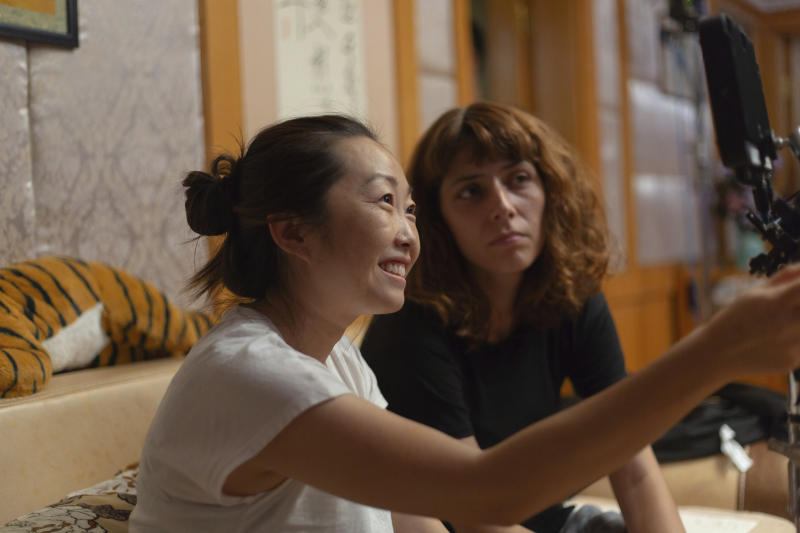 """This image released by A24 shows director Lulu Wang, left, on the set of """"The Farewell."""" Women directed 12 of 2019's top 100-grossing films in 2019, according to a study released Thursday by USC Annenberg Inclusion Initiative Female filmmakers. (Casi Moss/A24 via AP)"""