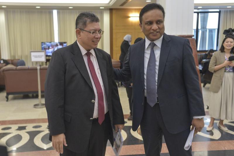 Foreign Affairs Datuk Saifuddin Abdullah shares a light moment with Kepala Batas MP Datuk Seri Reezal Merican (right) at Parliament November 7, 2019. — Picture by Shafwan Zaidon