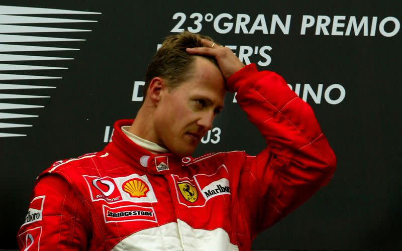 FILE PHOTO: Ferrari's Michael Schumacher is overcome with emotion on the winners podium after claiming victory in the San Marino Grand Prix at Imola just hours after his mother Elisabeth, who was in a coma, died in Cologne.