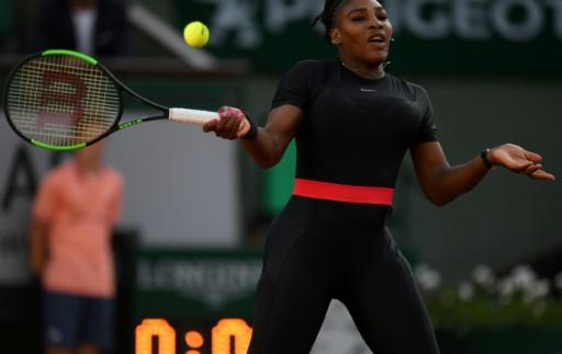 Power: Serena Williams  plays a forehand return to Australia's Ashleigh Barty