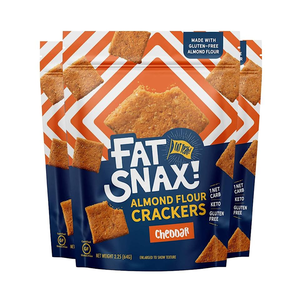 "<p>We are saying yes please to these cheddar <product href=""https://www.amazon.com/Fat-Snax-Keto-Crackers-Keto-Friendly/dp/B0897YRXQN/ref=sr_1_3?crid=29ZQJSLOGJEDU&amp;dchild=1&amp;keywords=fat+snax+crackers&amp;qid=1598651842&amp;sprefix=fat+%2Caps%2C235&amp;sr=8-3"" target=""_blank"" class=""ga-track"" data-ga-category=""internal click"" data-ga-label=""https://www.amazon.com/Fat-Snax-Keto-Crackers-Keto-Friendly/dp/B0897YRXQN/ref=sr_1_3?crid=29ZQJSLOGJEDU&amp;dchild=1&amp;keywords=fat+snax+crackers&amp;qid=1598651842&amp;sprefix=fat+%2Caps%2C235&amp;sr=8-3"" data-ga-action=""body text link"">Fat Snax Keto Crackers</product> ($35 for eight).</p>"