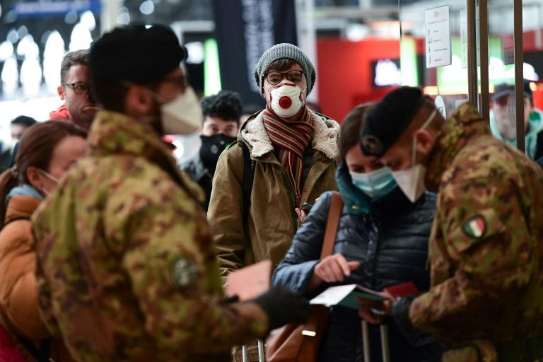 Rail passengers told AFP their identity documents were being checked on arrival to make sure they were residents of Milan