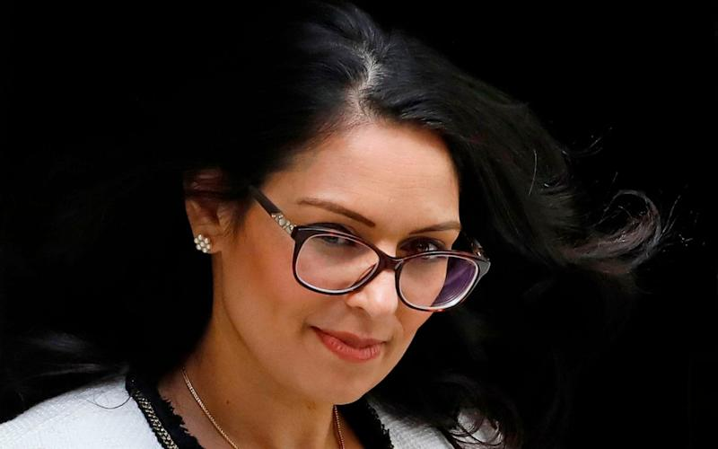 Priti Patel has been urged to explains what steps will be taken when quarantine rules are removed - Tolga Akmen/AFP