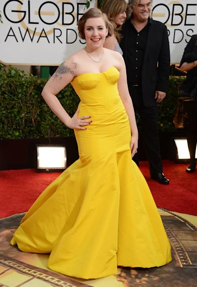 Lena Dunham arrives at the 71st annual Golden Globe Awards at the Beverly Hilton Hotel on Sunday, Jan. 12, 2014, in Beverly Hills, Calif. (Photo by Jordan Strauss/Invision/AP)