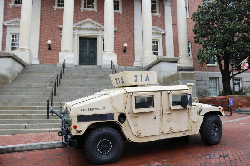A military vehicle is parked in front of the Maryland State House on Thursday, March 19, 2020 in Annapolis, Md. Maryland Gov. Larry Hogan, who chairs the National Governors Association, said the group of governors is asking the federal government to give governors maximum flexibility for the use of the National Guard. (AP Photo/Brian Witte)