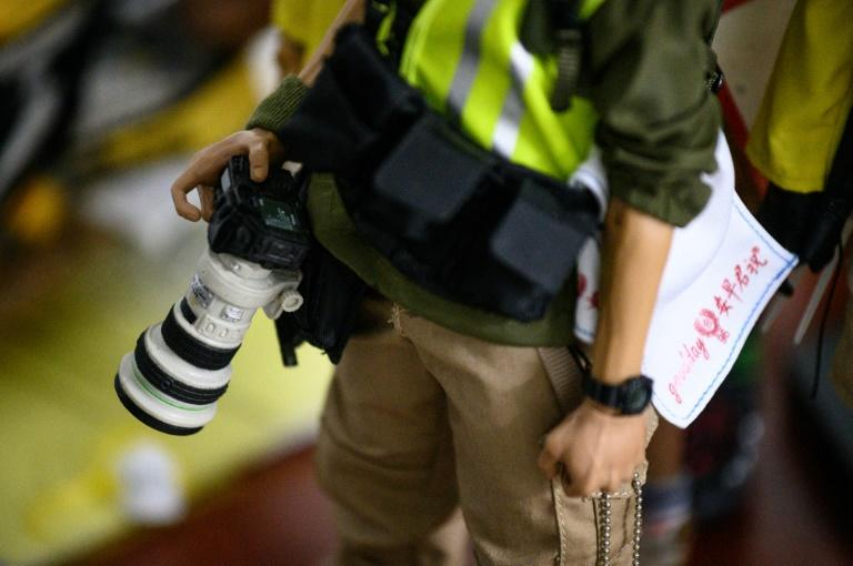 Among the 1:6 scale figures are journalists and white-collar workers