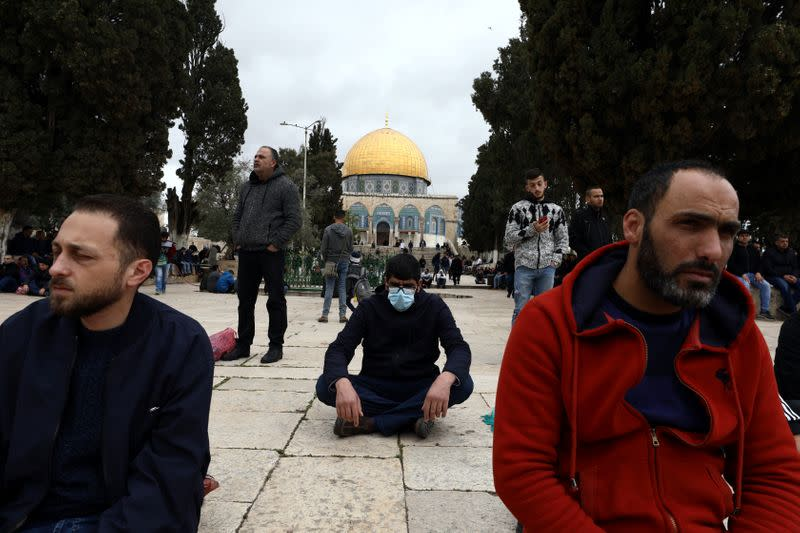 Worshippers pray in front of the Dome of the Rock in the compound known to Muslims as Noble Sanctuary and to Jews as Temple Mount, in Jerusalem's Old City