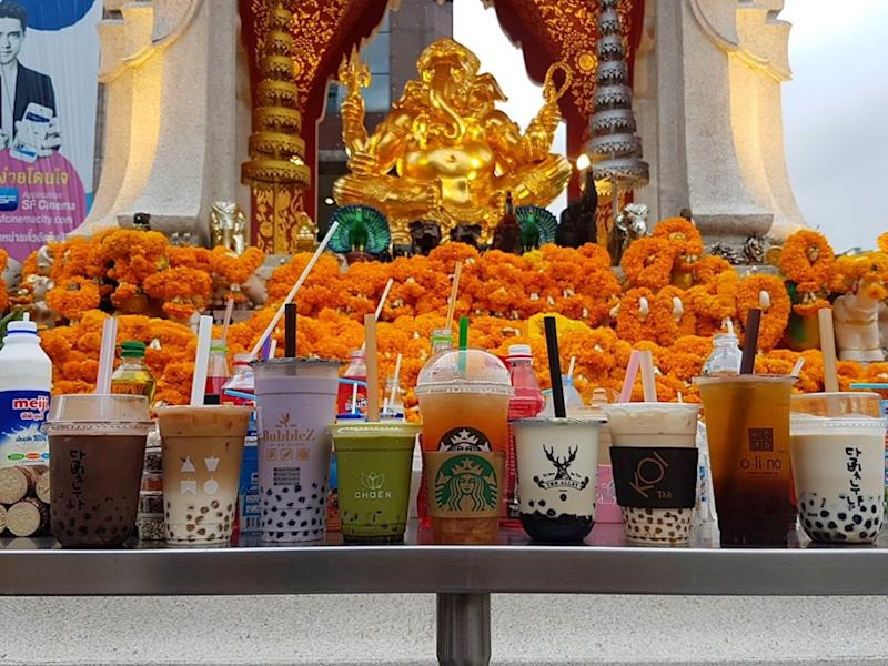 The trendy beverage has earned a spot next to the usual flowers and fruits offerings. ― Picture from Facebook/Payunbud