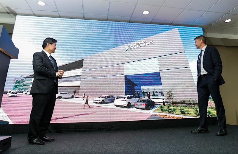 Penang Chief Minister Chow Kon Yeow (left) and National Instruments president and CEO Eric Starkloff (right) viewing a montage during the official site opening of the company's new expanded unit in Batu Maung November 21, 2019. — Picture by Sayuti Zainudin