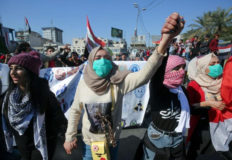 Iraqi students during an anti-government demonstration in Baghdad's Tahrir square in February, a month before the spread of coronavirus escalated into a major global crisis