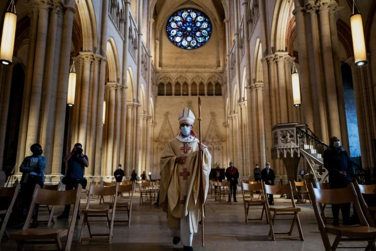 Bishop Emmanuel Gobilliard arrives to celebrate the first mass since the beginning of the lockdown due to Covid 19 pandemic in Saint-Jean cathedral in Lyon