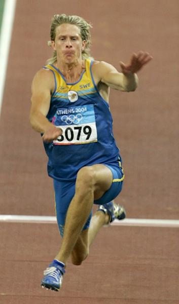 FILE PHOTO: Christian Olsson of Sweden competes in triple jump at Athens 2004 Olympic Games.