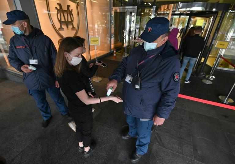Mall customers are required to observe social distancing and wear masks and gloves to protect themselves and others against the virus