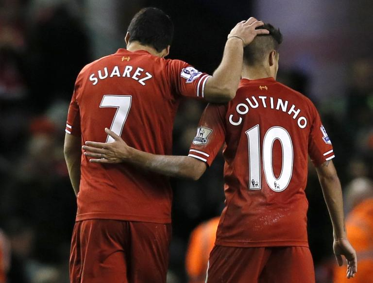 Liverpool's Suarez and Coutinho embrace following their English Premier League soccer match against Fulham at Anfield in Liverpool