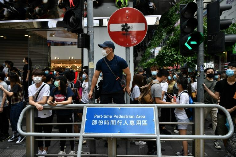 Thousands of people gathered in Hong Kong to protest against a proposed security law despite regulations prohibiting groups of more than eight people