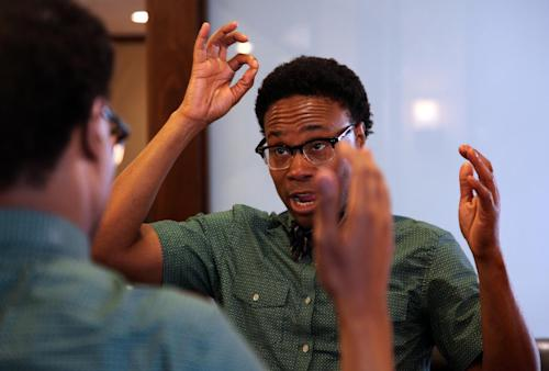 "This May 31, 2013 photo shows Tony Award nominee Billy Porter tweaking his new haircut at the men's spa BBraxton in the Harlem neighborhood of New York. Porter hopes to win his first Tony as best actor in a musical for his role as a drag queen in ""Kinky Boots."" (AP Photo/Mark Kennedy)"