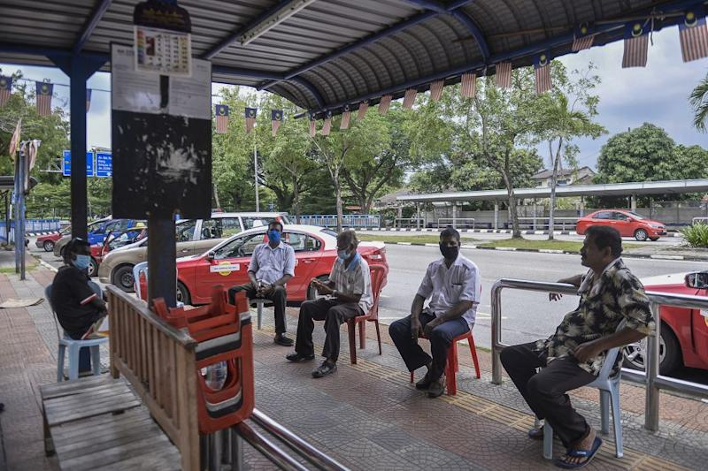 Taxi drivers wait for passengers at a taxi station in Shah Alam May 6, 2020. — Picture by Miera Zulyana