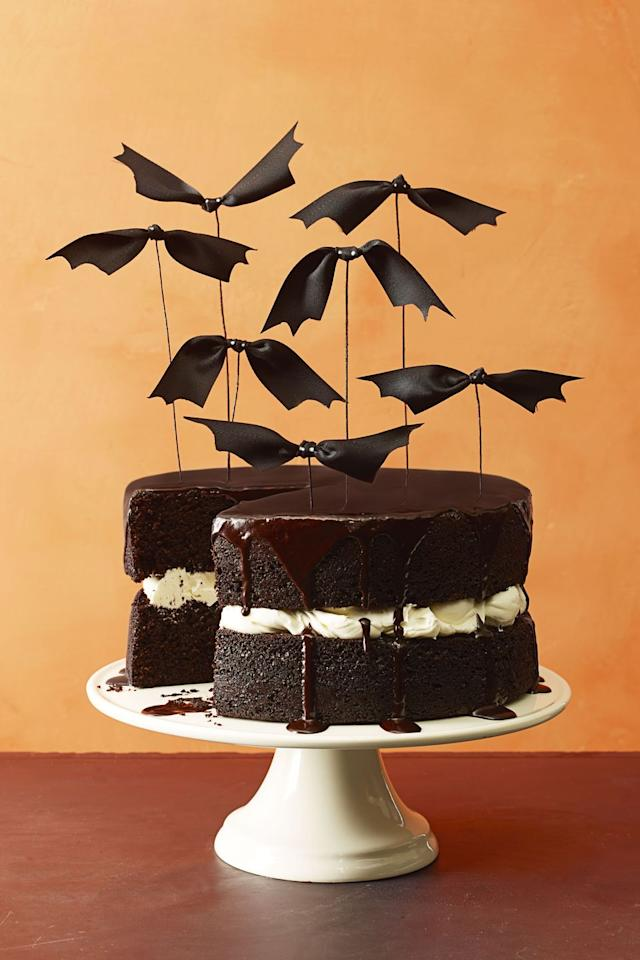 """<p>Give this layered chocolate cake an instant Halloween upgrade with centerpiece-worthy ribbon bats. </p><p><em><a href=""""https://www.goodhousekeeping.com/food-recipes/a16014/chocolate-pumpkin-cake-recipe-ghk1014/"""" target=""""_blank"""">Get the recipe for Chocolate Pumpkin Cake »</a></em></p><p><strong>RELATED: </strong><a href=""""https://www.goodhousekeeping.com/food-recipes/g3639/best-pumpkin-recipes/"""" target=""""_blank"""">43 Sweet and Savory Pumpkin Recipes to Make This Fall</a><strong></strong></p>"""