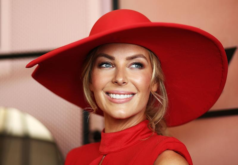 Jennifer Hawkins former Miss Universe poses at Melbourne Cup Day