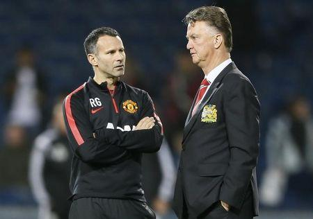 Manchester United manager Louis van Gaal and assistant Ryan Giggs chat ahead of their team's English Premier League soccer match against West Bromwich Albion at The Hawthorns in West Bromwich