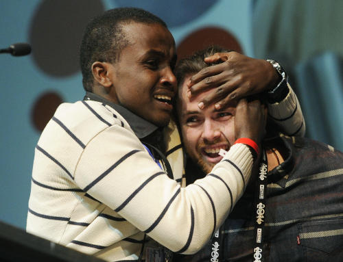 "Cutter Hodierne, right, director of ""Fishing Without Nets,"" is embraced by cast member Abdikani Muktar after winning the Directing Award: Dramatic for his film during the 2014 Sundance Film Festival Awards Ceremony on Saturday, Jan. 25, 2014, in Park City, Utah. (Photo by Chris Pizzello/Invision/AP)"