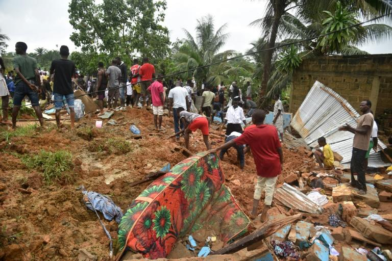 People search for survivors and bodies in the rubble of their former homes