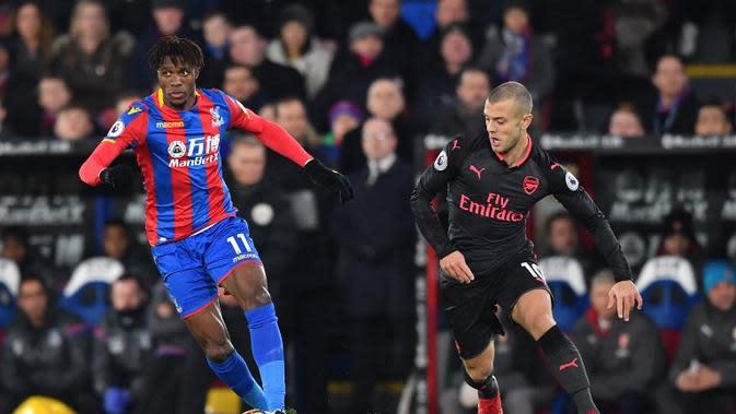 Penyerang Crystal Palace, Wilfried Zaha bakal jadi andalan lawan Arsenal nanti (AFP/Ben Stansall)