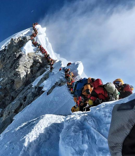 Dozens of climbers waiting to ascend Mount Everest